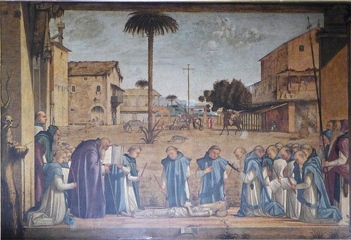 Das in der Scuola di San Giorgio degli Schiavoni in Venedig ausgestellte Bild zeigt trauernde Klosterbrüder, die mit Totenkerzen neben dem ausgezehrten am Boden liegenden Leib des 98jährig verstorbenenheiligen Hieronymus knien